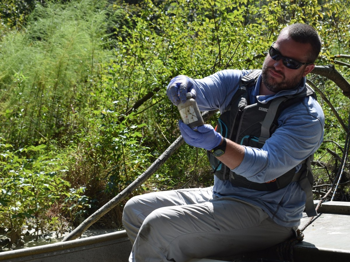 Riverkeeper Matthew Star collects water sample from floodwaters after Florence.