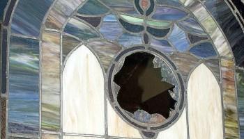 Broken window at the Hosanna Baptist Church of Graham County