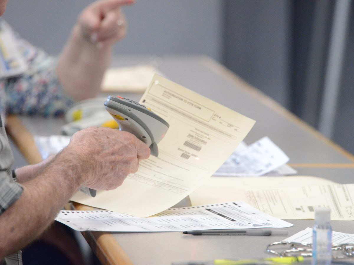 mail A poll worker in Nash County scans 2020 primary election voters' paperwork before giving them ballots at the Braswell Memorial Library polling place in Rocky Mount on March 3, 2020. Calvin Adkins / Carolina Public Press