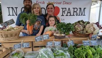 In Good Heart Farm of Chatham County is a family farm operation. Pictured at their farmers market booth are Patricia Parker, Ben Shields, Elliott Shields, and Abilene Parker. Photo courtesy of Debbie Roos, Chatham County Agricultural Extension