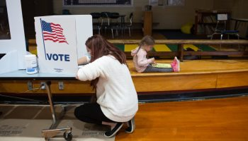 Laura Young and Daughter voting
