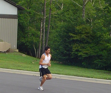 Hector Sanchex Taking 2nd Place Overall at the Sourwood 5k