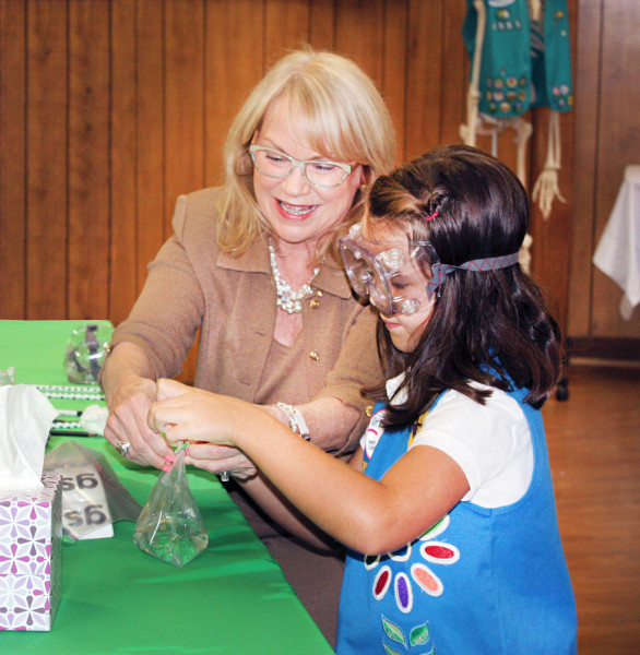 Cathy Bessant Assists Girl Scout with STEM Experiment