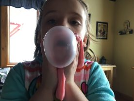 Ellie is obsessed with blowing bubbles.