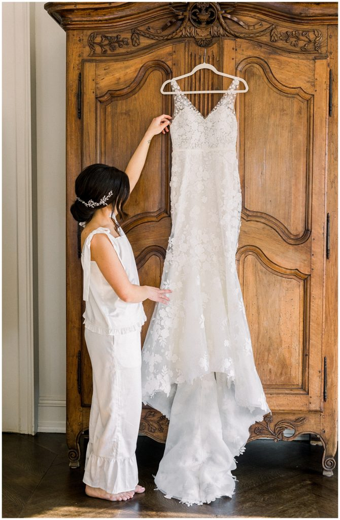 bride looking at wedding dress at Park Chateau in New Jersey