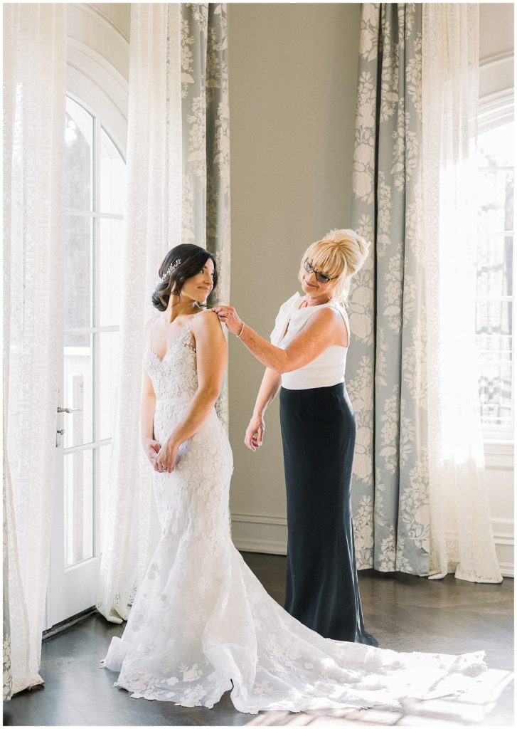 bride putting on wedding dress at Park Chateau in New Jersey