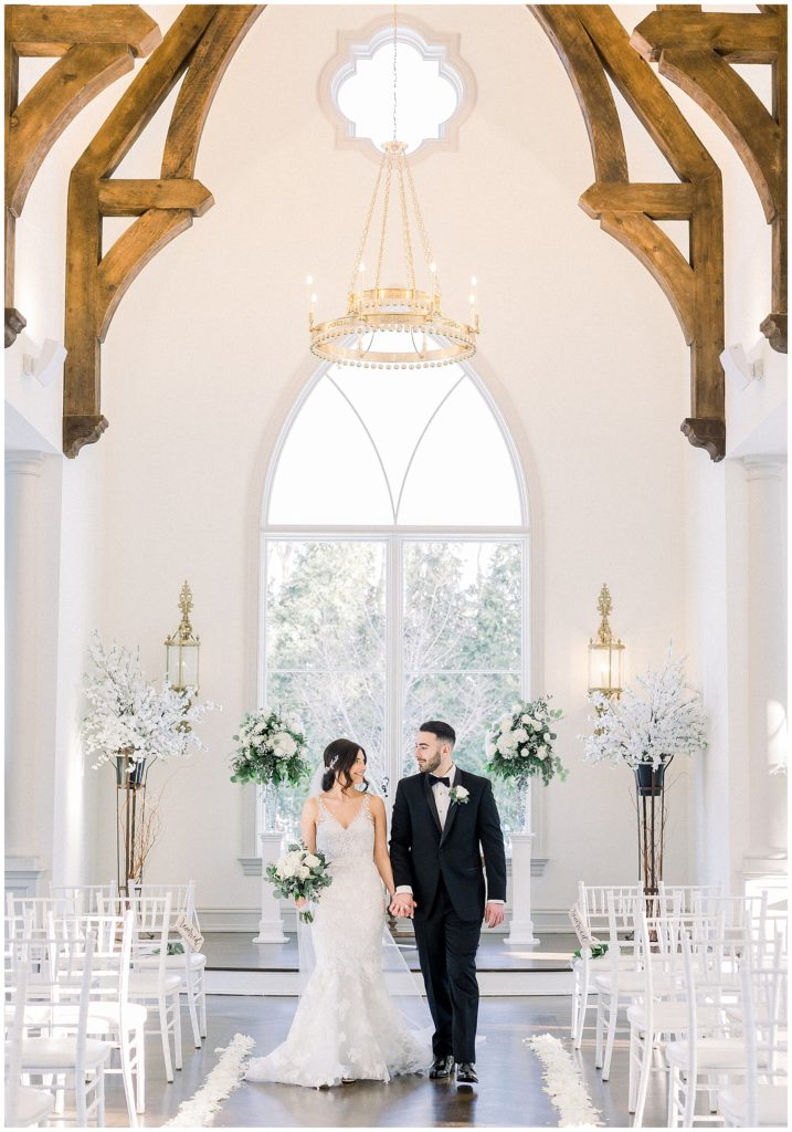 bride and groom in white chapel at their Park Chateau wedding