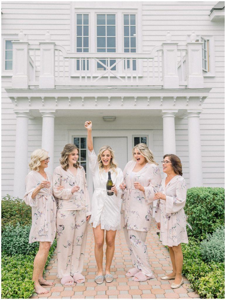 bridesmaids drinking champagne at Ryland Inn wedding