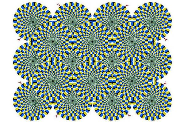 Bei dieser Abbildung scheinen sich die Räder zu drehen - tatsächlich bewegt sich aber überhaupt nichts! Der Effekt entsteht durch die vielen verschiedenfarbigen Elemente, aus denen sich das Bild zusammensetzt. Unser Gehirn versucht, das Gesehene zu erfassen und einzuordnen, findet hier allerdings keinen Orientierungspunkt. Die räumliche Lage der Objekte kann nicht zugeordnet werden.