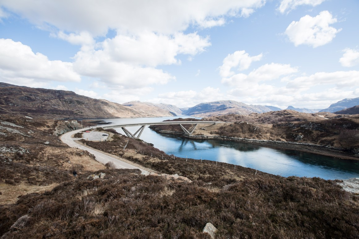 Wide image of Kylesku Bridge and surrounding mountains