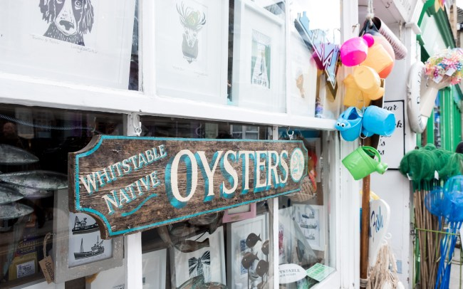 Rustic wooden sign for oysters in a shop on Whitstable high street