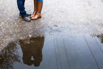 Photo of puddle with couple kissing reflection