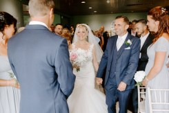 Bride seeing her groom for the first time on wedding day