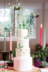 Pink and gold 4 tiered wedding cake with cacti decor
