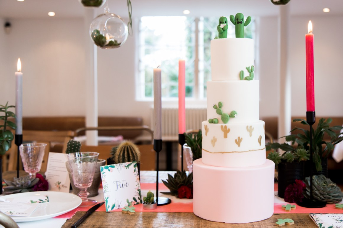 4 tier vegan wedding cake with cacti toppers and decoration