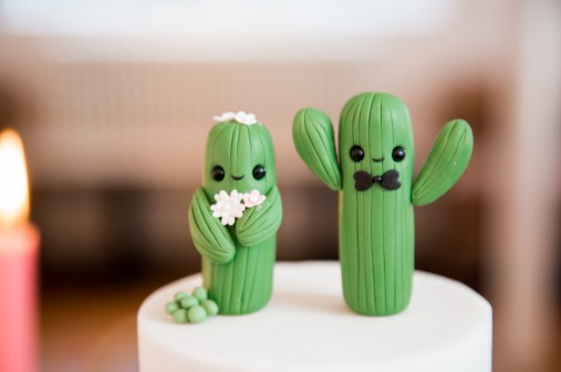 Two small cacti bride and groom cake toppers