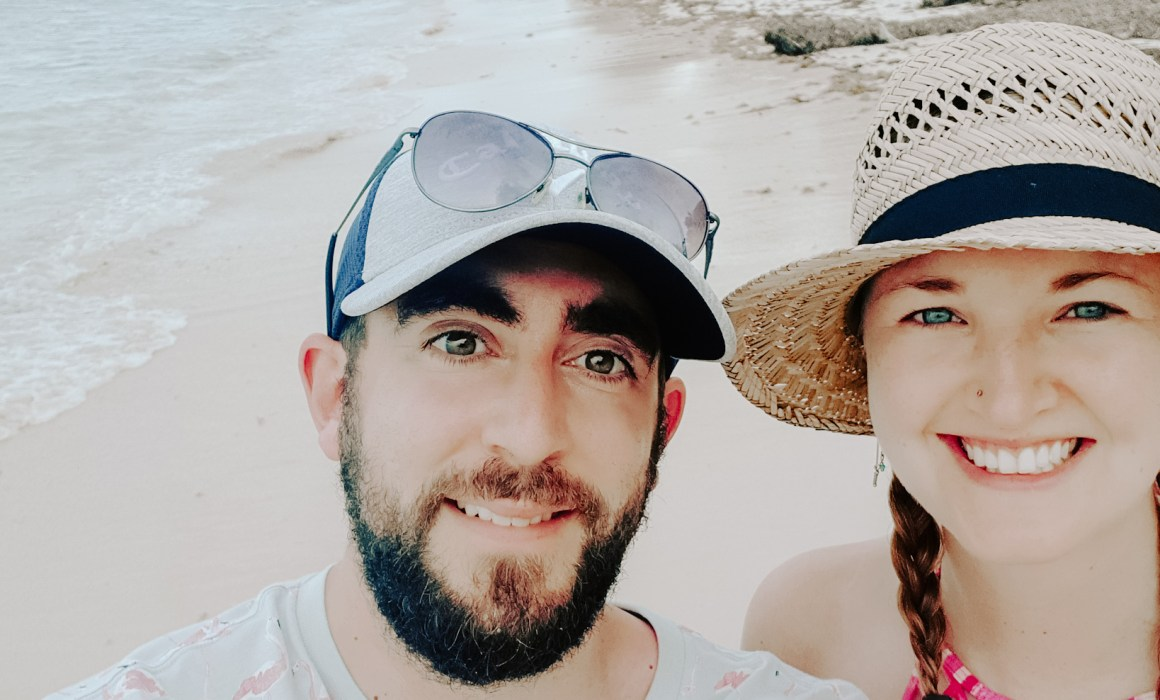 Smiling couple on a carribbean beach