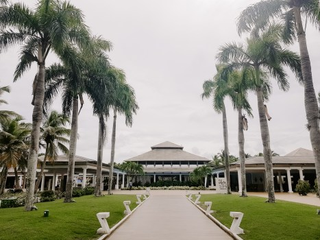 A Dominican Republic hotel resort with palm trees and outdoor walkway