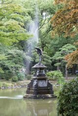 Fountain surrounded by orange trees in Hibiya Park Tokyo