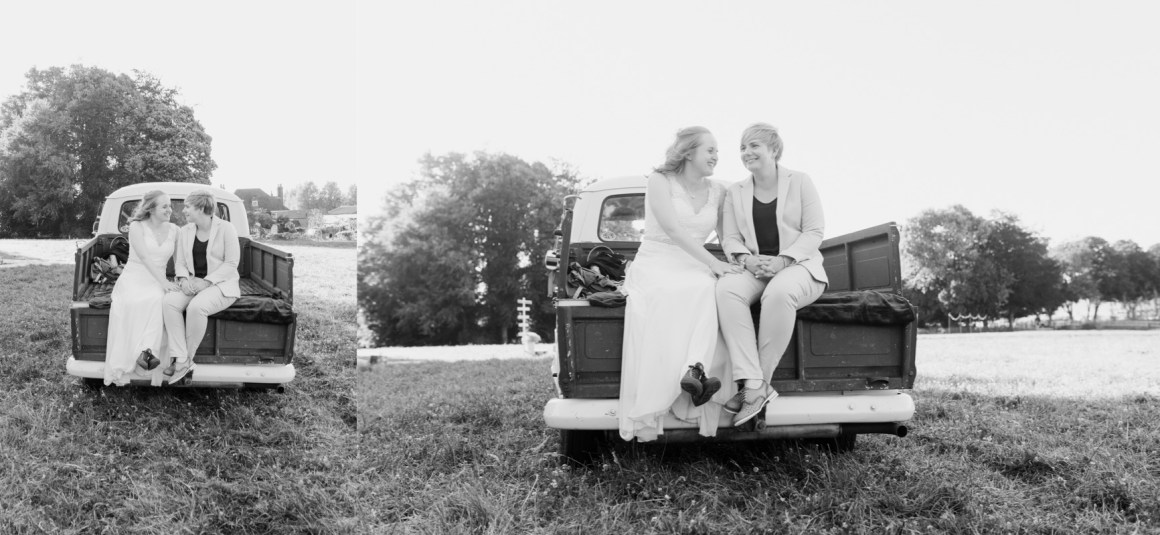 Newly married brides at on the back of a VW pick up
