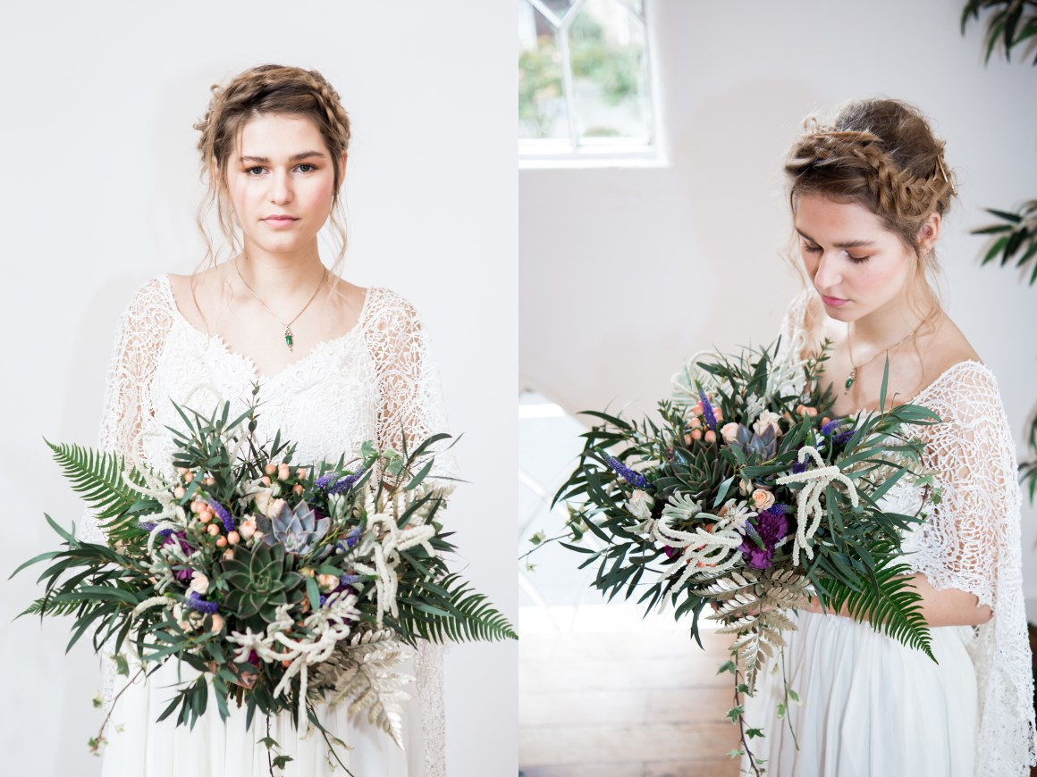 Beautiful bohemian bride holding a large wild bouquet