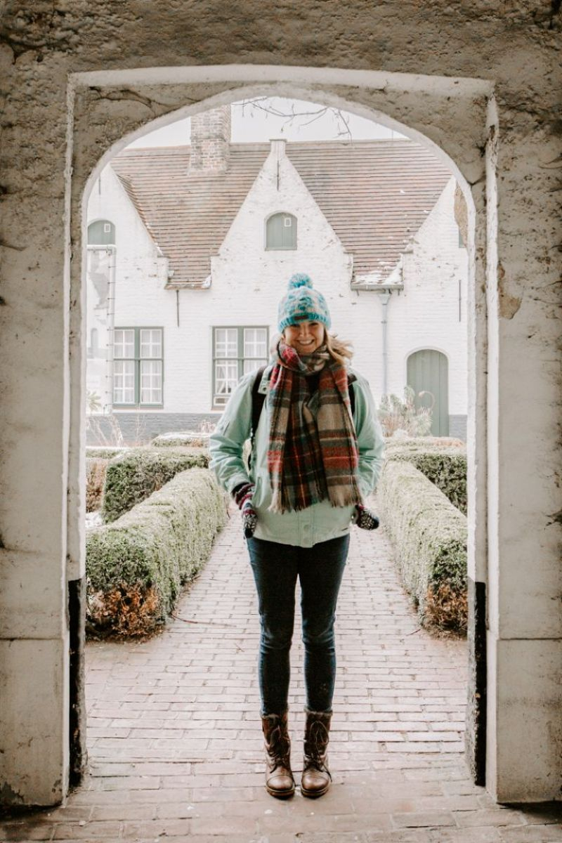 Woman exploring Bruges in winter