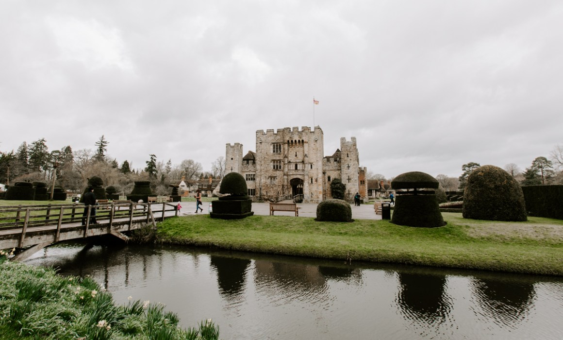 Hever Castle on a cloudy day with moat in front