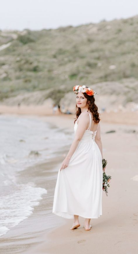 Bohemian bride on Għajn Tuffieħa beach in Malta