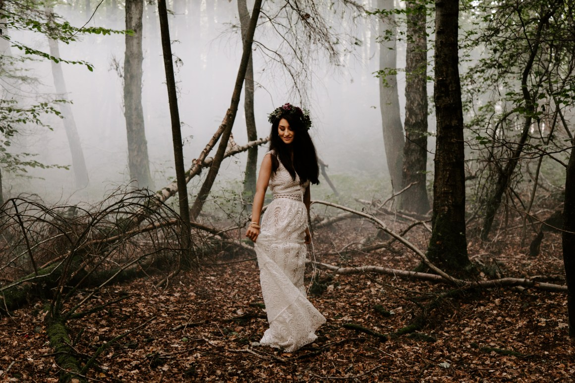 Bohemian bride in the woods with a smoke bomb