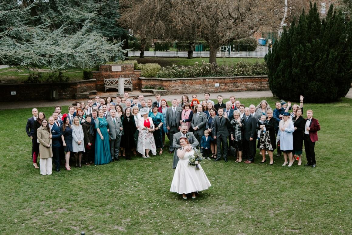Group shot of wedding party outside the Tudor Barn Eltham