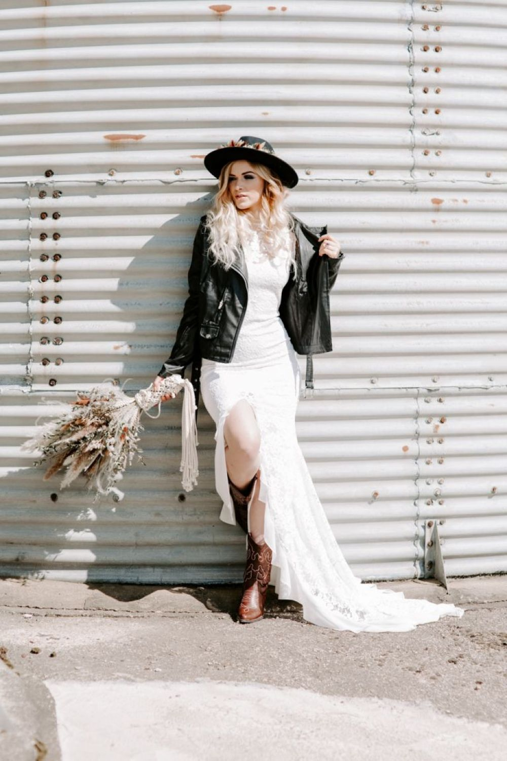 Bride wearing leather jacket and boho hat