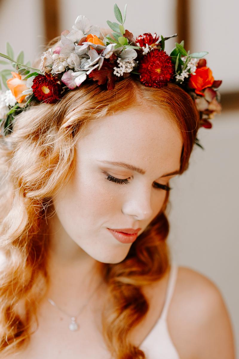Autumn bride wearing floral crown