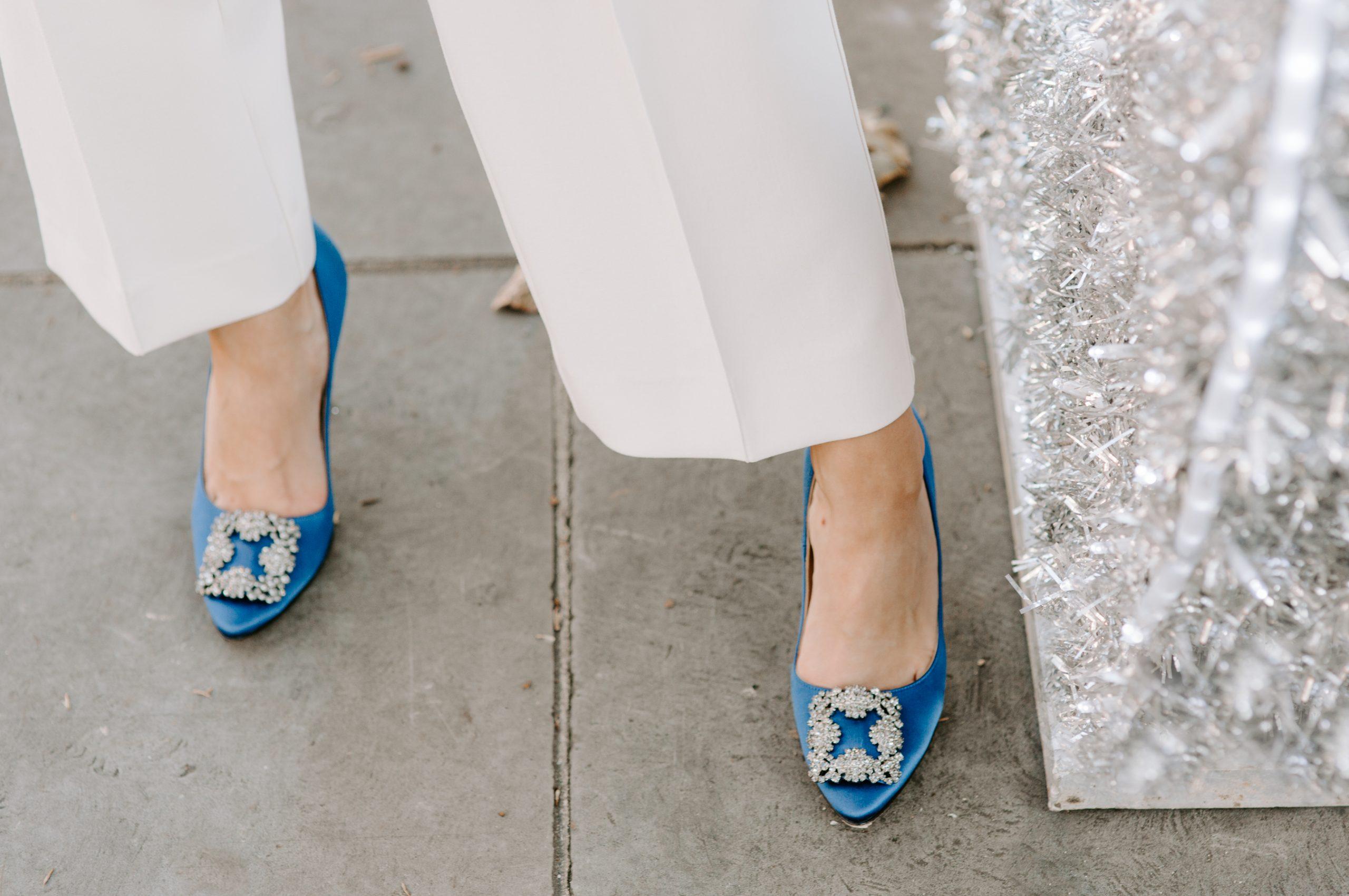 Bride wearing bright blue wedding shoes