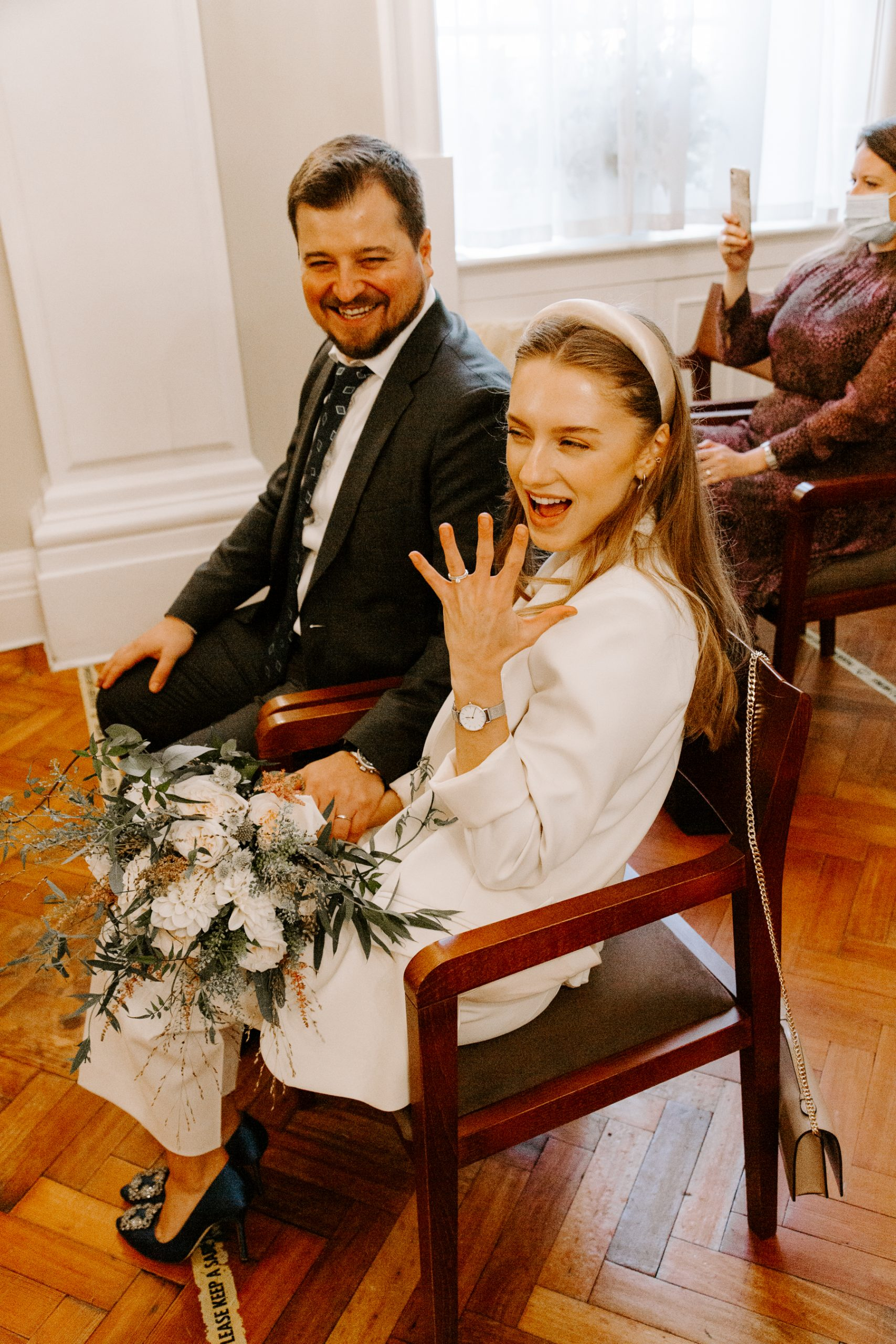 Bride showing off her wedding ring after London COVID Elopement