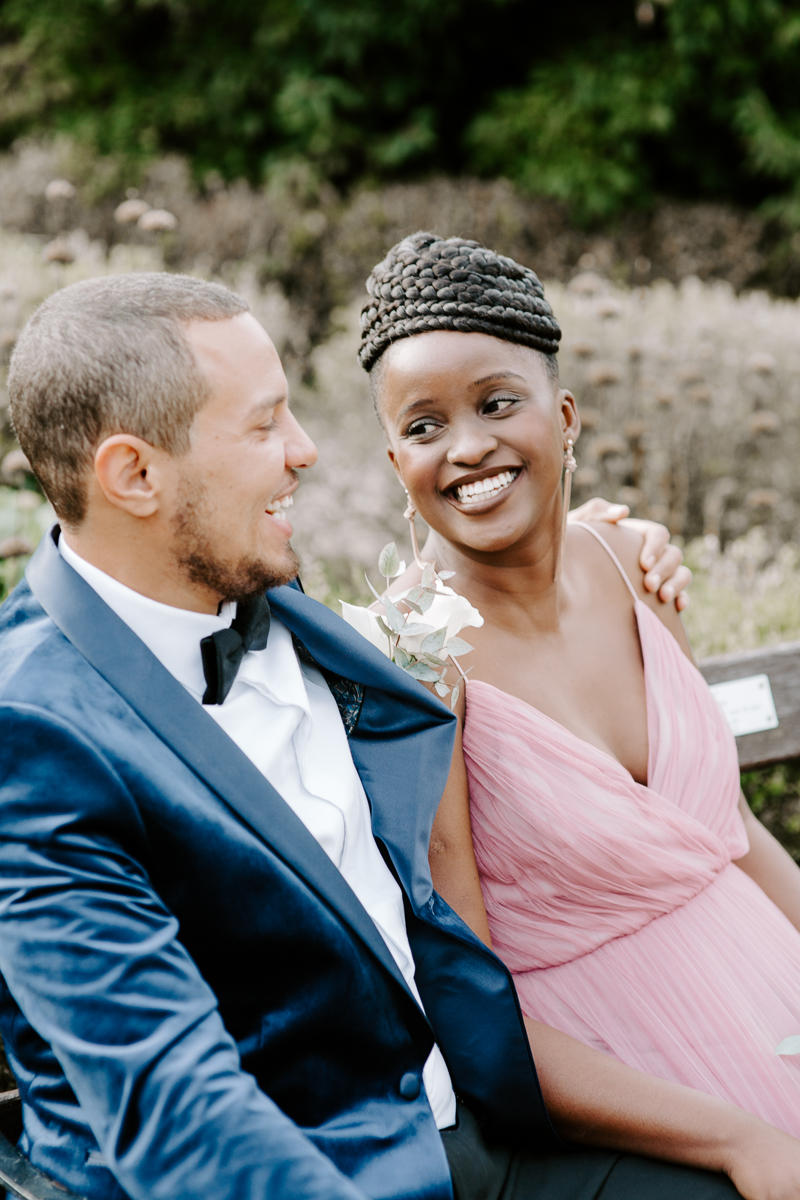 Laughing bride and groom in East London