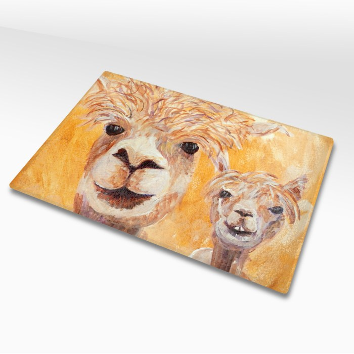 Tempered glass cutting board with golden yellow alpaca image
