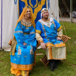 Thomas and Raziya sitting next to each other after being invested as the new Baronial Heads.