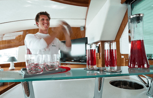Bartender Shakes Red Drinks on 62ft Sailing Yacht Catamaran BELLA PRINCIPESSA at Cliffs sleeps 6