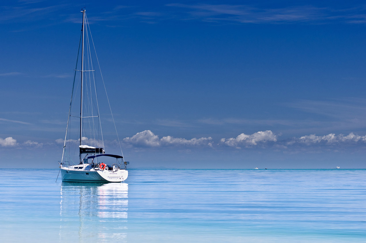 Sailboat on calm water in The Caribbean