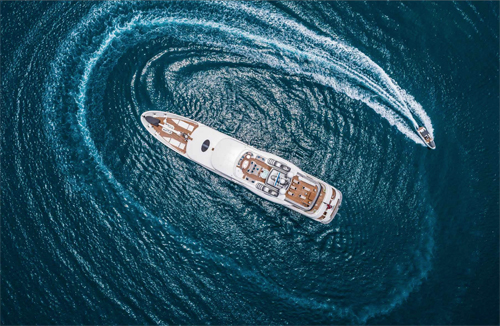 Motor yacht CALYPSO M-Y w Circling Tender Aerial View