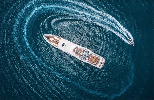 Motor yacht CALYPSO M-Y w Circling Tender Aerial View
