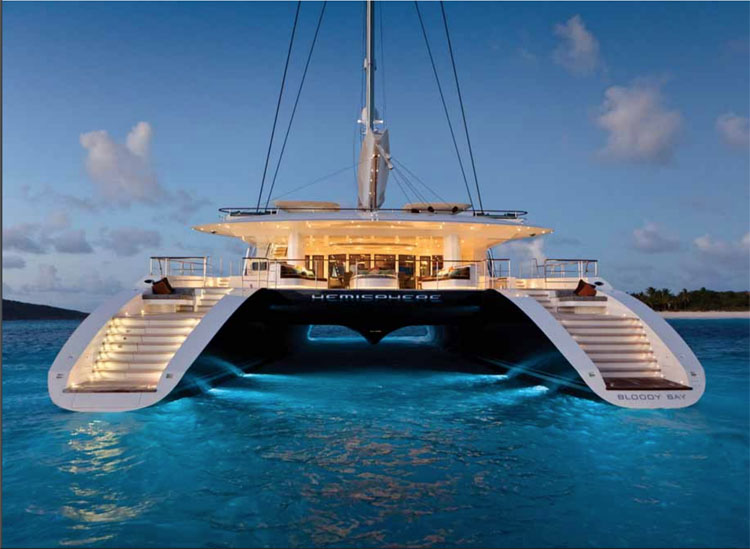 Aft view of the multi-hulled 145ft HEMISPHERE with evening lighting