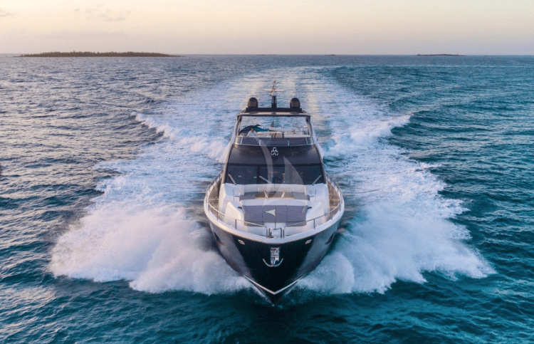 The motor yacht ENTERPRISE moving at full speed on the ocean at dusk