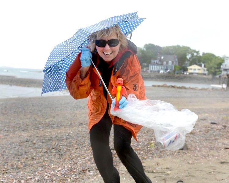 Carol Kent cleaning up Preston Beach in Marblehead, Massachusetts