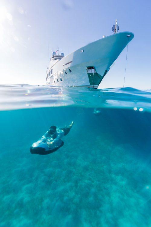 Underwater Seabob scooter driven by motor yacht LADY JOY passenger