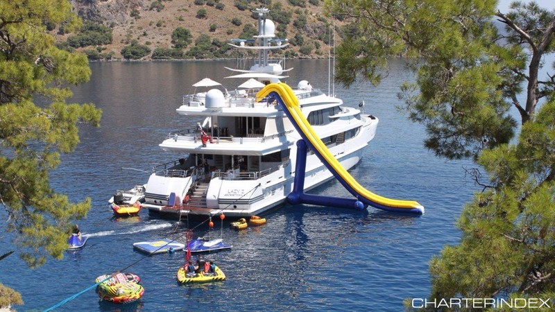 170ft motor Oceanco motor yacht LAZY Z stern view with slide, toys and tenders
