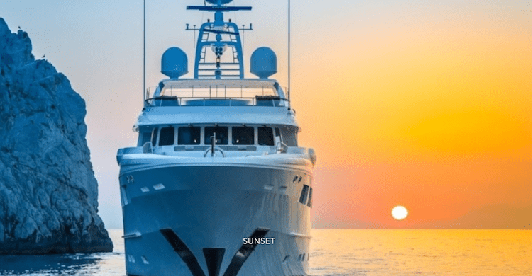 Head on shot of 128ft Hakvoort motor yacht REVELRY at sunset