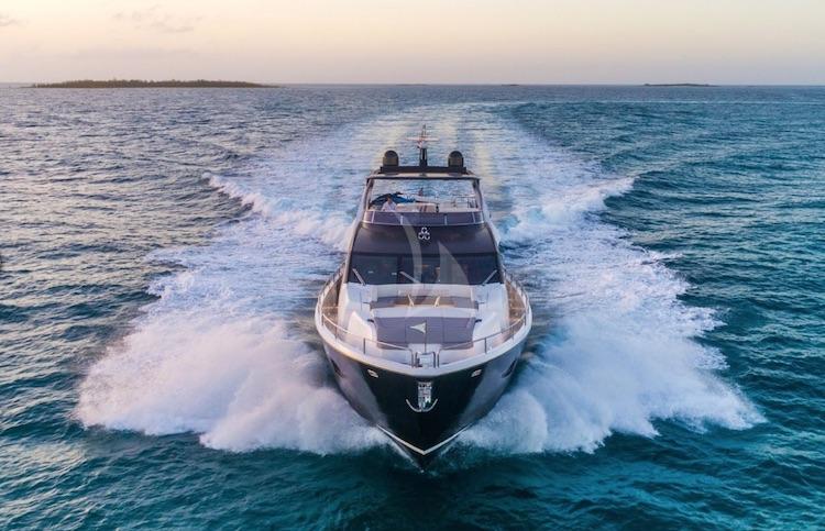 The motor yacht ENTERPRISE moving at full speed on the ocean at dusk