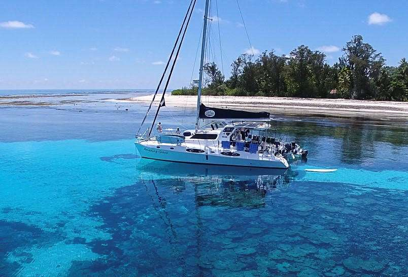 53ft Royal Cape S-Y Catamaran AMAZING GRACE moored near a white sand island