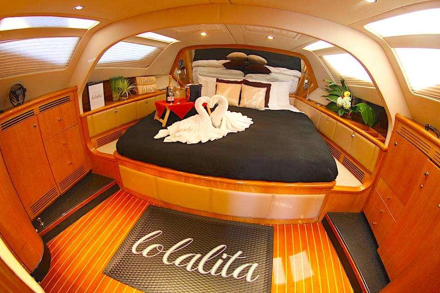 King cabin with swan towels on 65ft Privilege Yard sailing catamaran LOLALITA